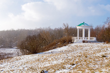 Gazebo in historical park Home of the Gentry in the winter snowstorm, Oryol. Russia