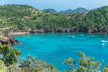 Guadeloupe, beautiful seascape of the Saintes islands, typical houses and sailboats in the bay
