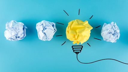 Creative idea, Inspiration, New idea and Innovation concept with Crumpled Paper light bulb on blue background.