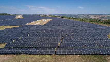 Aerial shot of photovoltaics solar farm. Solar farm power station from above. Ecological renewable energy.