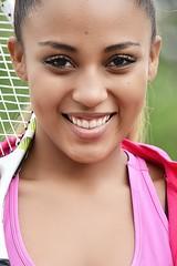 Hispanic Girl Tennis Player Smiling