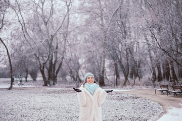 Smiling young woman in snowing outdoor