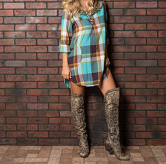 Beautiful Woman in a Plaid Summer Dress and Knee High Boots