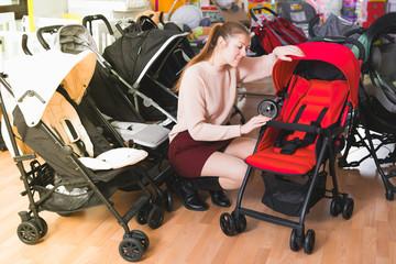 buyer choosing stroller cane in the shop