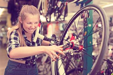 Portrait of female who is repairing wheels