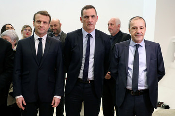 French President Emmanuel Macron, Gilles Simeoni, leader of Corsica's regional council, and Jean-Guy Talamoni, Corsica's regional parliament speaker, pose during the president's visit to the Corsican Territorial Collectivity in Ajaccio