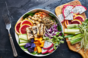 healthy buddha bowl in flat lay composition with colorful ingredients