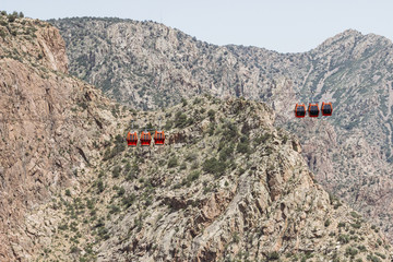 Overhead cable cars against mountains