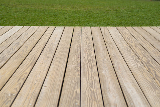 wood deck and grass background