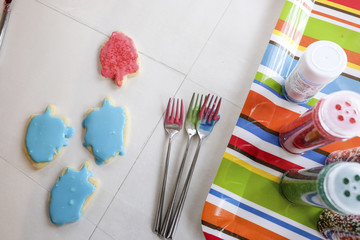 Close-up of food colored cookies on table at home