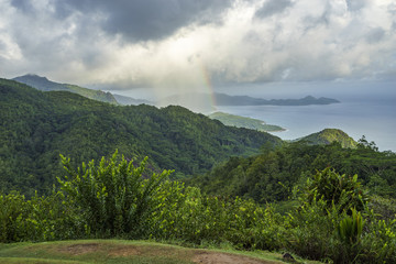 rainbow and rain over the jungle and mountains of mahé, seychelles 4