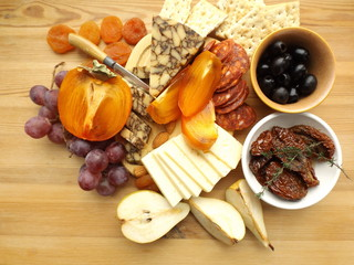 Cheese board, cheddar usual and seasoned in porter. Fruits, chorizo and olives.