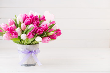 Pink tulip on the white background. Easter background