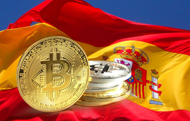 Bitcoin coins on Spain flag, Cryptocurrency concept photo