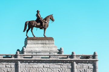 Soldier on a horse statue on a blue skies