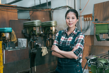 confident happy lathe factory woman employee