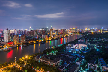 Illuminated city near river by night, Shanghai, China