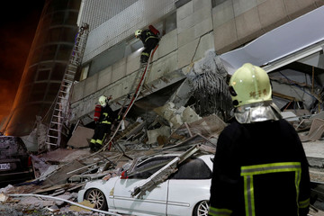 A fireman works at a collapses building after earthquake hit Hualien