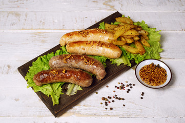 Meat fried sausages on a wooden table