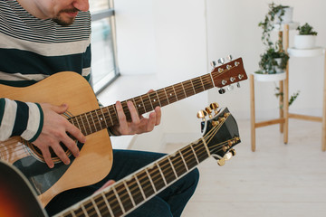 Learning to play the guitar. Music education and extracurricular lessons. Hobbies and enthusiasm for playing guitar and singing songs.