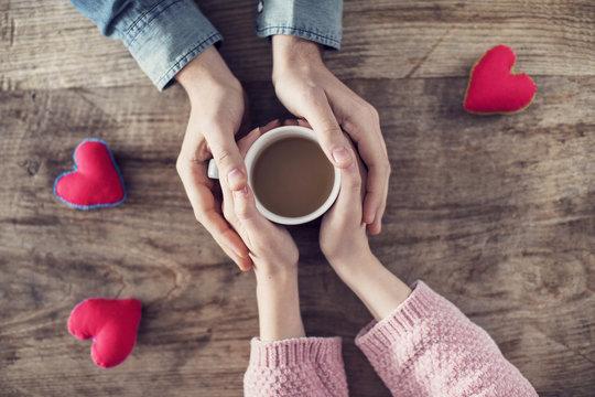 Lover holding coffee mug