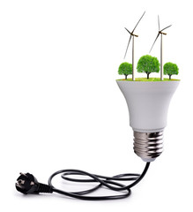Wind turbines and trees in LED bulb with electric plug isolated on white background.Saving lamp. Green energy theme.