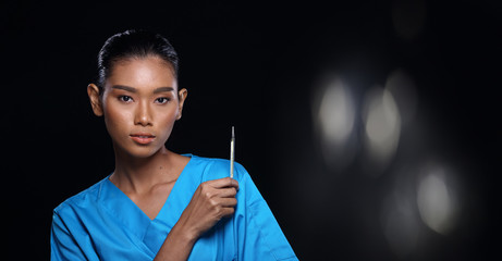 Doctor Nurse in white blue shirt with syringe