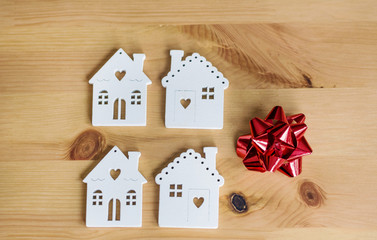 Small White Houses Models On Wooden Background