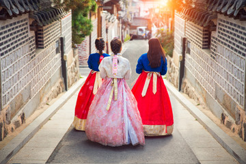 Korean lady in Hanbok walk in an ancient town