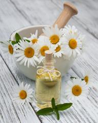 Massage oil and chamomile
