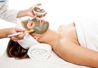 Woman having face mask at spa