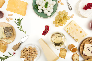 Selection of cheeses on white with copy space