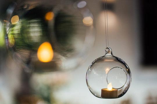 Beautiful hanging glass balls for candles, close-up. Modern wedding decor tendencies. Minimalism.
