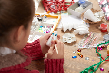 Child make crafts and toys, handmade concept. Artwork workplace with creative accessories.
