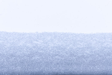 An inside look at the window, covered with snow and snowfall.