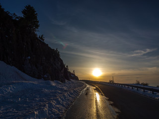 I was returning home after climbing to the summit of kissavos mountain, and i saw this amazin colors of sunset,reflecting on ice in the road.