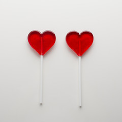 Two candy hearts on white background isolated. Minimal love concept. Romantic Style.