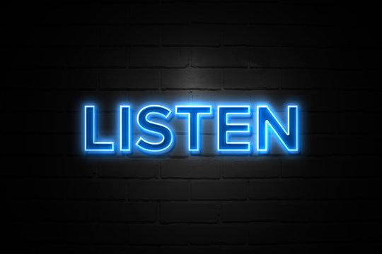Listen neon Sign on brickwall