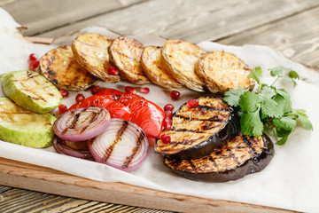 grilled vegetables. Serving on a wooden Board on a rustic table. Barbecue restaurant menu, a series of photos of different dishes