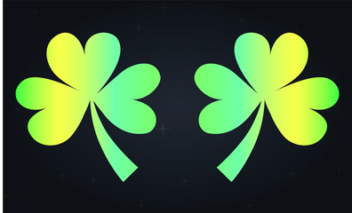 Two green neon clovers are symbols of luck and wealth. St. Patrick's Day Festival