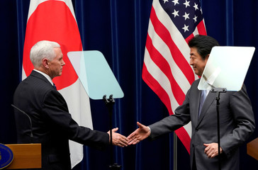U.S. Vice President Pence shakes hands with Japan's PM Abe during a joint announcement at Abe's official residence in Tokyo