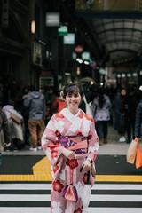 Beautiful asian girl wearing traditional japanese kimono in Asakusa Tokyo, Japan.