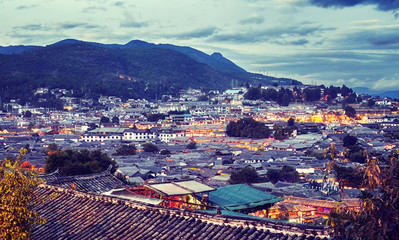 Color toned picture of the old town of Lijiang at dusk. This historical center, also known as Dayan, was registered on the UNESCO World Heritage List in 1997, China.