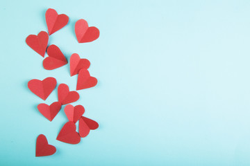 Paper hearts on blue background