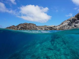 Rocky coastline and rock underwater, split view above and below water surface, Cap de Creus, Mediterranean sea, Spain, Costa Brava, Catalonia