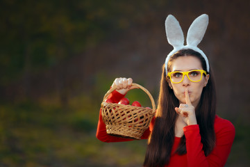 Easter Girl with a Basket of Red Eggs Keeping a Secret