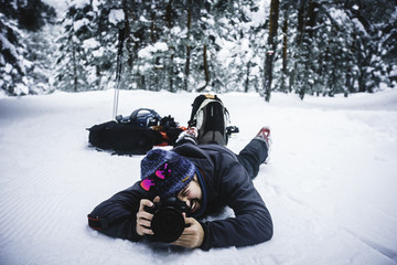 Photographer shooting at the snow