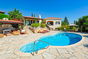Private swimming pool and patio area