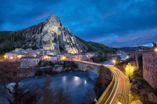 Sisteron in the evening: The Rocher de la Baume - peculiar shaped rock and bridge over Durance river, Alpes-de-Haute-Provence, France