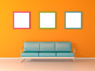 Nice waiting room with with blue sofa three picture frames on yellow wall